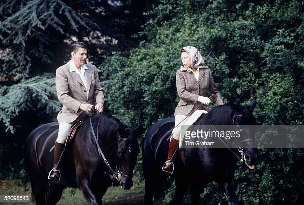 The Queen Riding With President Ronald Reagan In The Grounds Of Windsor Castle During His State Visit She Is Riding Her Horse Burmese And He...