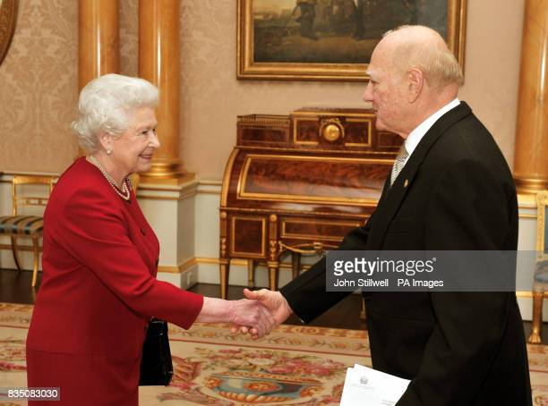 The Queen shakes hands with His Excellency the Ambassador of El Salvador Dr Roberto AvilaAvilez at Buckingham Palace where he presented his...