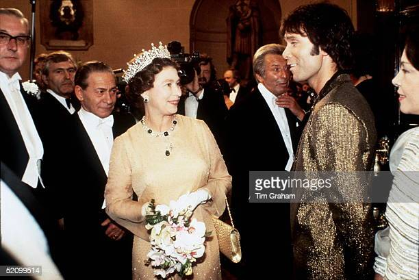 The Queen Sharing A Joke With Singer Cliff Richard After Watching Him Perform At The Royal Variety Show In London