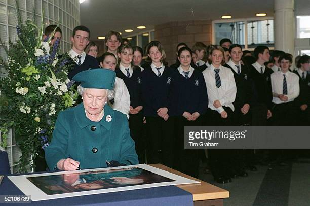 The Queen Signs A Portrait During A Trip To Durrington High School In Worthing West Sussex