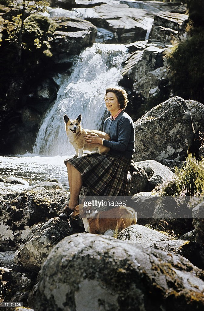 The Queen Sitting By A Waterfall : News Photo
