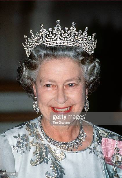 The Queen Smiling During A Royal Tour She Is Wearing A White Crepe Evening Dress Embroidered With Silver By Designer Ian Thomas The Queen Is Wearing...