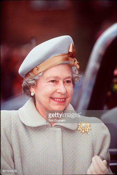 The Queen Smiling On A Visit To Newbury She Is Wearing A Pale Blue And Beige Hat And Coat