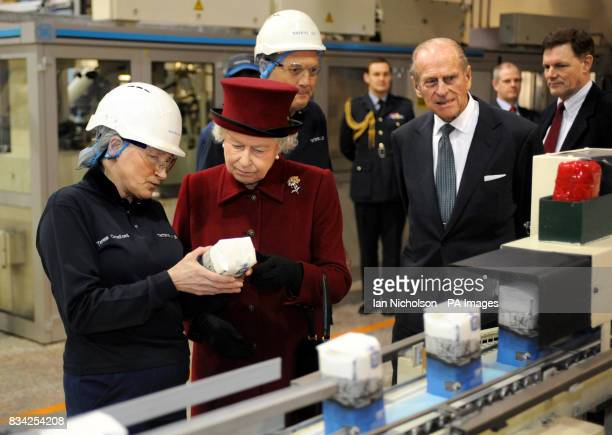 The Queen speaks to Tate Lyle Packing Area Supervisor Teresa Croxford during a visit with the Duke of Edinburgh to the east London sugar refinery...