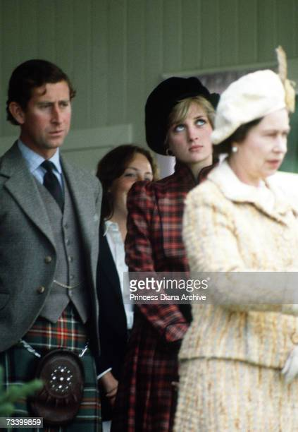 The Queen stands with the Prince and Princess of Wales at the Braemar Highland Games in Scotland September 1981 The Princess wears a tartan suit by...