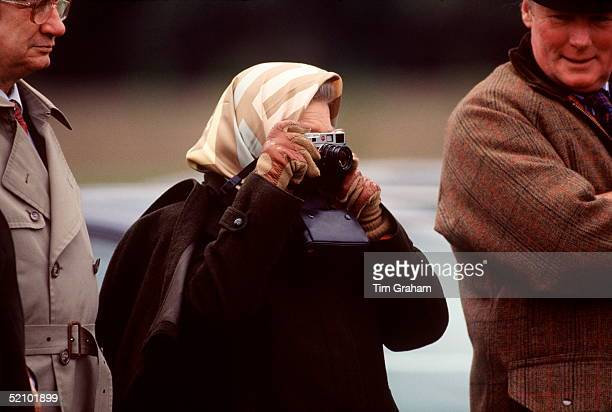 The Queen Taking A Photograph During The Royal Windsor Horse Trials, Windsor, Berkshire.