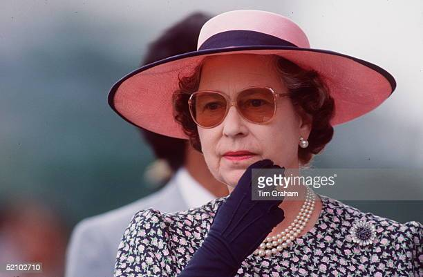 The Queen Touching Her Chin During A Visit To The Selangor Turf Club In Malaysia