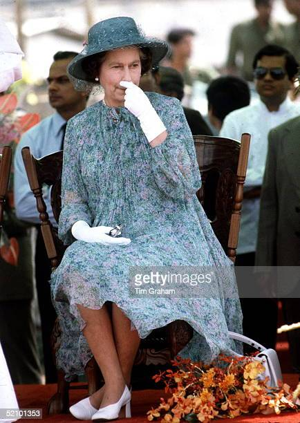 The Queen Touching Her Nose During Visit To Papua New Guinea