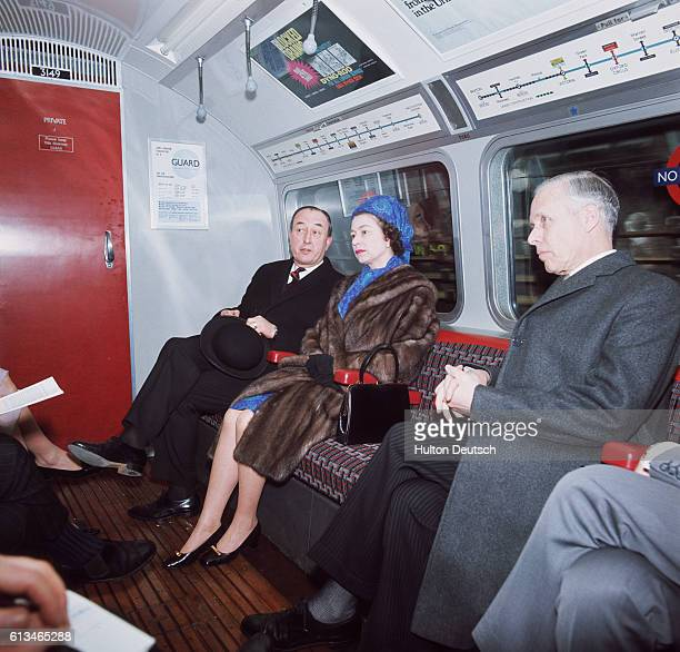 The Queen travelling on the London Underground after officially opening the Victoria Line service
