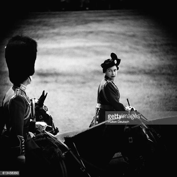 The Queen turns towards the Duke of Edinburgh during the 1961 Trooping the Colour ceremony to mark her 35th birthday.
