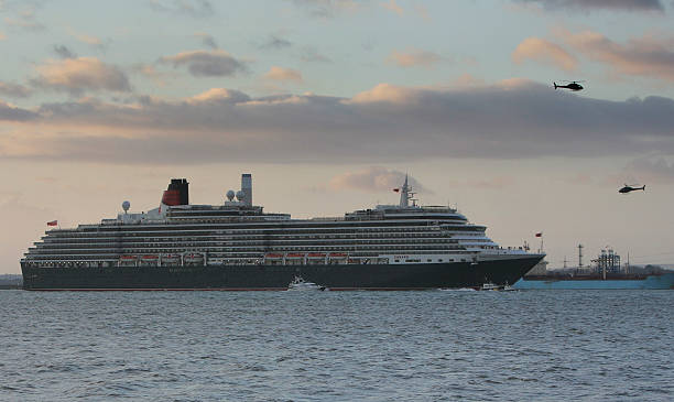 Quels sont vos paquebots préférés de la Cunard Line ? The-queen-victoria-cruise-liner-arrives-in-southampton-on-december-7-picture-id78298810?k=6&m=78298810&s=612x612&w=0&h=RIBrj_QZpE6_9Hu_2k0DO9kWssf6G3cvnRrkHpptO3k=