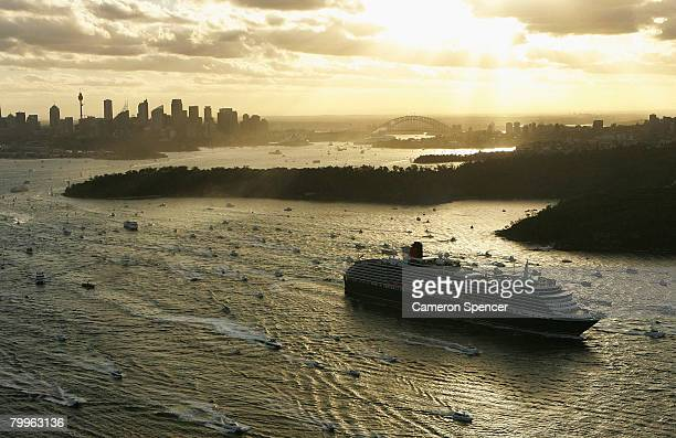 The Queen Victoria Ship heads through Sydney Harbour after a rendezvous with the fellow Cunard luxury liner the Queen Elizabeth II at Garden Island...