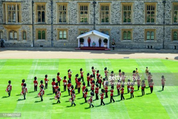 The Queen views a military ceremony by soldiers from the 1st Battalion Welsh Guards to mark the official birthday of Britain's Queen Elizabeth II in...