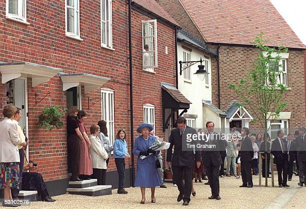 The Queen Visiting The Prince Of Wales's Poundbury Development Dorchester Dorsetbehind The Queen And Her Host Is Her Police Bodyguard Ken Atmore