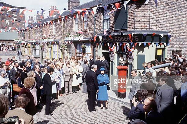 The Queen Visiting The Television Set Of 'coronation Street' In Manchester Characters From The Series Including Annie Walker Bet Lynch And Mike...