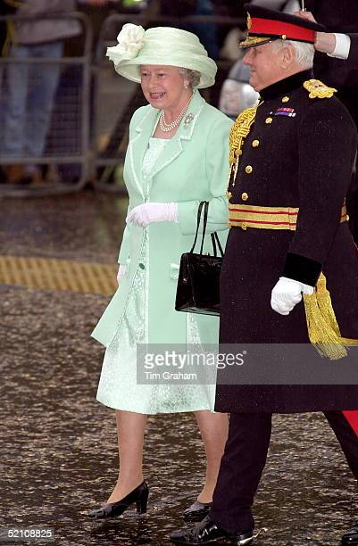 The Queen walks with the Lord Lieutenant upon Arriving To Open The Tate Modern Gallery Bankside London