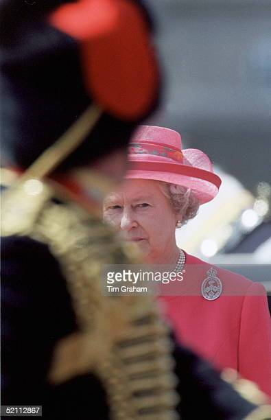 The Queen Watching Trooping The Colour On Her Official Birthday In London