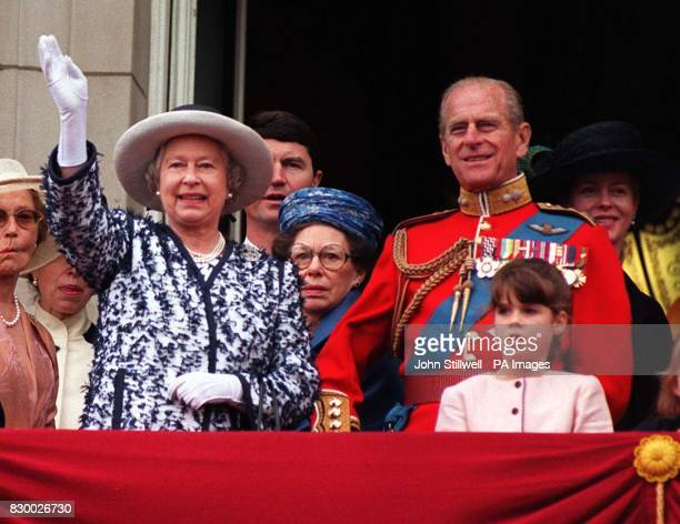 The Queen waves to the crowds as she stands on the balcony of Buckingham Palace with the Duke of Edinburgh and other members of the Royal Family...