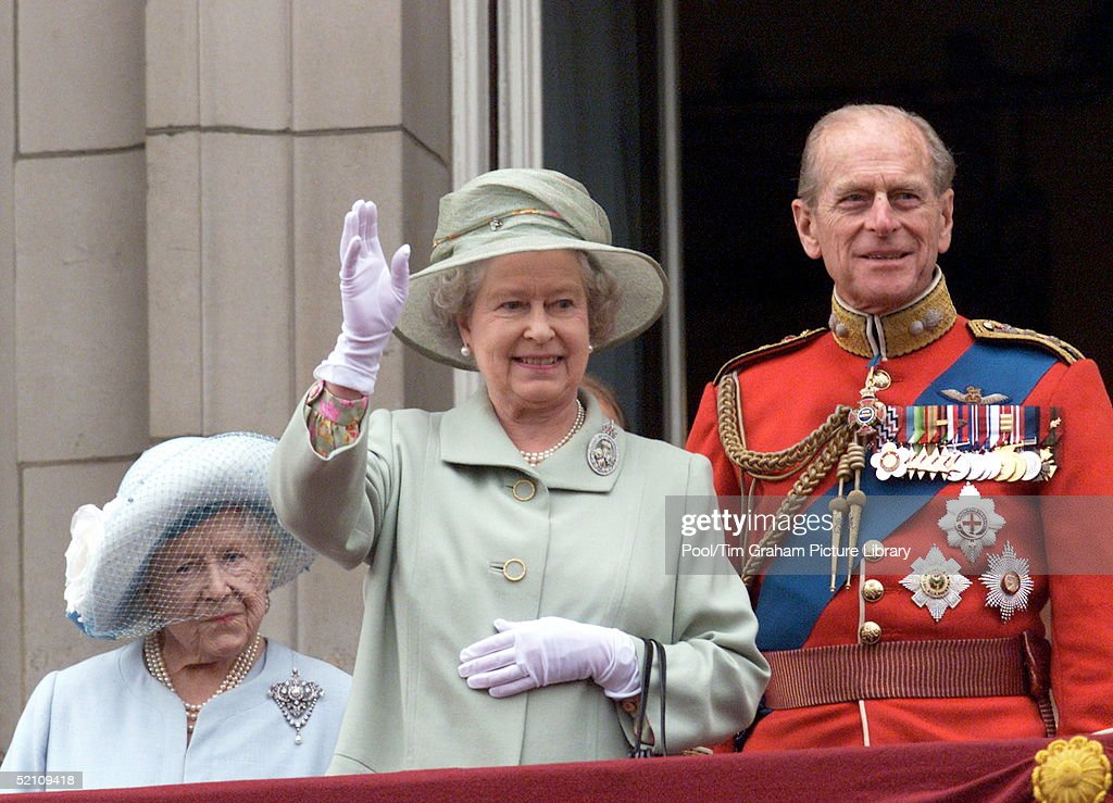 The Queen Waving To The Crowds From The Balcony Of Buckingham Palace, London. The Queen Mother And Prince Philip [ Duke Of Edinburgh ] Accompany Her After Trooping The Colour - The Queen's Official Birthday Which Is Celebrated Each Year With A Military Parade And March-past.