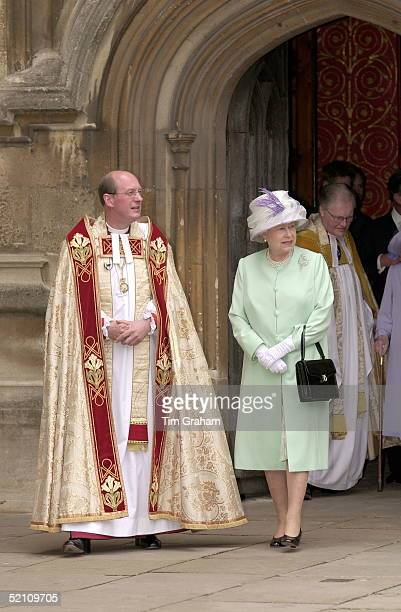 The Queen Wearing A Pale Green Coat And A Cream Hat Trimmed With Net And Purple Feathers Leaving The St George's Chapel After A Service To Mark The...