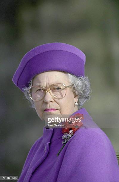 The Queen Wearing Poppies At The Unveiling Of A Statue To Sir Winston Churchill In Paris.