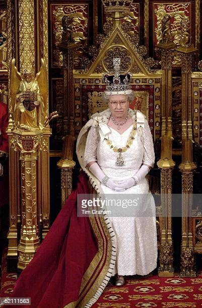 The Queen Wearing The Imperial State Crown Preparing To Read Her Speech To The House Of Lords At The State Opening Of Parliament In London