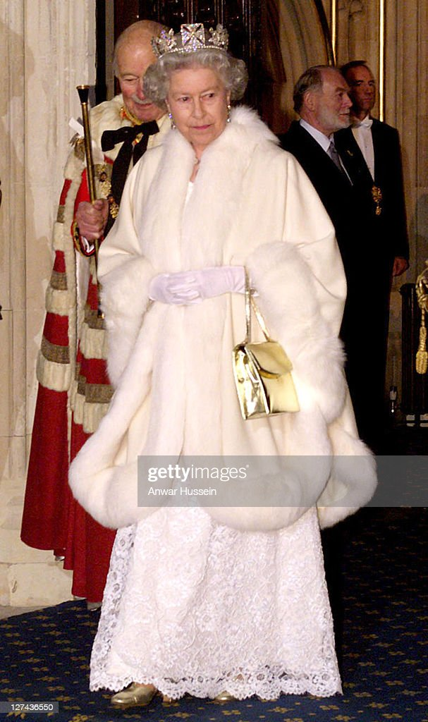 The Queen wearing tiara, evening dress and a white fur coat leaving the House of Lords on November 24th, 1998 after setting out the government's legislative programme for the coming year