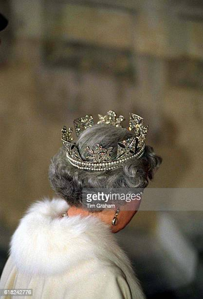 The Queen wears the diamond diadem decorated with symbolic roses shamrock and thistle