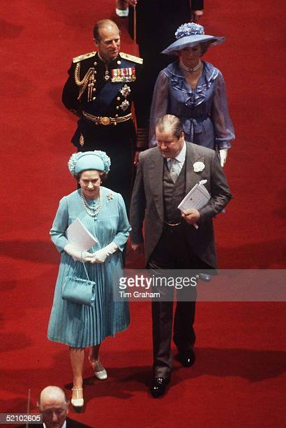 The Queen With Earl Spencer Followed By Prince Philip And Mrs Frances Shand Kydd Walking Down The Aisle In St Paul's Cathedral At The Wedding Of The...