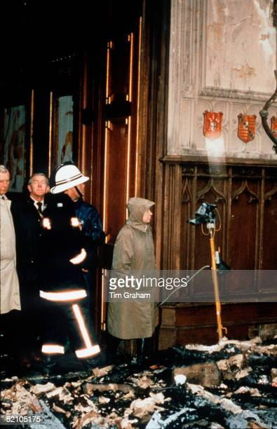 The Queen With Firemen Inspecting The Damage After The Fire At Windsor Castle
