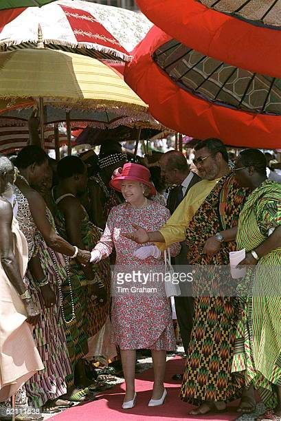 The Queen With Flight Lieutenant Jerry Rawlings President Of Ghana Attending A Durbar Of Chiefs Of Tribes During Her Visit To Accra Ghana