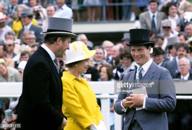 The Queen with her racing manager Lord Porchester and trainer Ian Balding in the paddock before the race in which her colt 'English harbour' was...