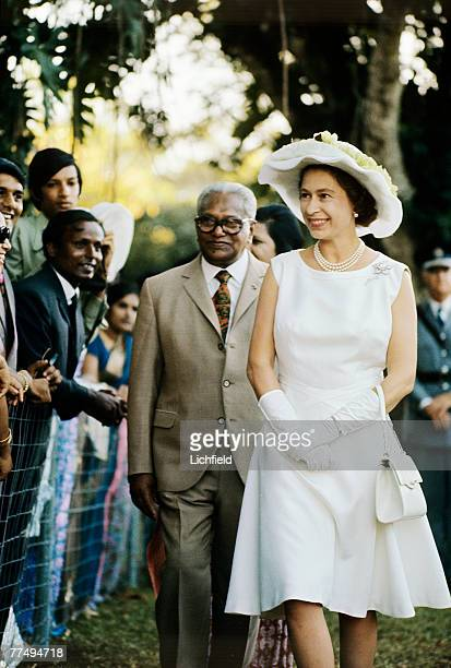 HM The Queen with Mauritian prime minister Sir Seewoosagur Ramgoolam on a walkabout in the Mauritius in March 1972 Part of a series of photographs...