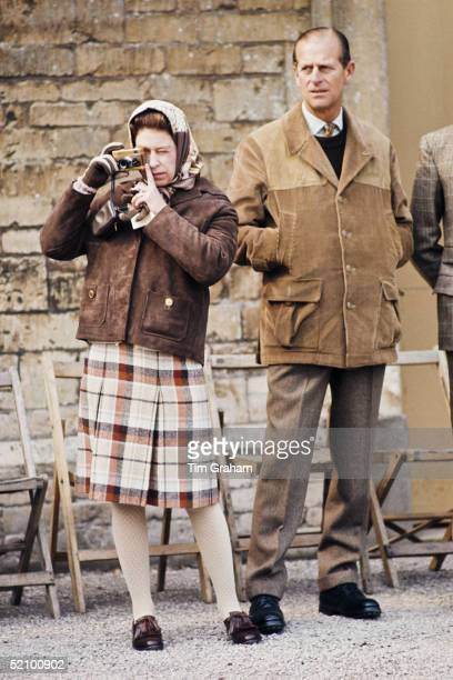 The Queen With Prince Philip Photographing A Horse At The Badminton Horse Trials