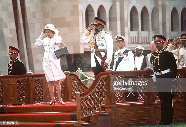 The Queen With Sultan Qaboos In Oman During The Arrival Ceremony At Sultan Qaboos' S Home Muscat Palace She Is Holding Onto Her Hat After It Had Been...