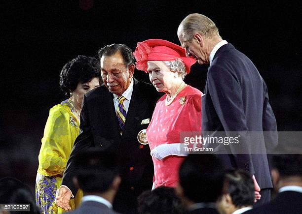 The Queen With The Agong At The Commonwealth Games Stadium.