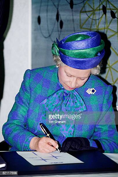 The Queen Writting During A Visit To The European Transonic Windtunnel Project In Bonn