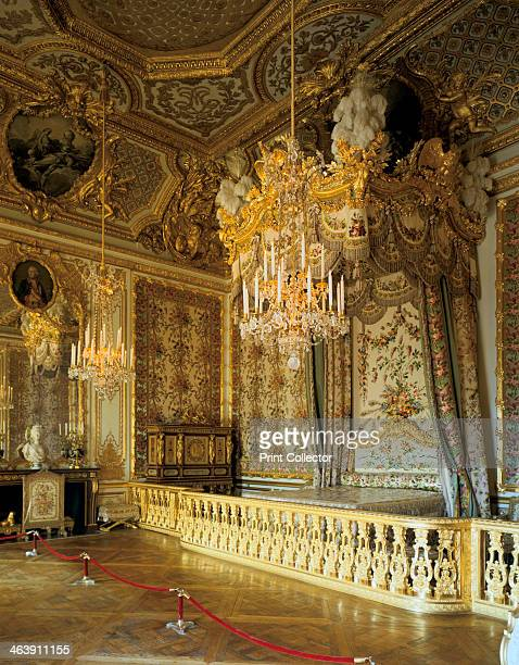 The Queen's Bedchamber The Queen's Suite Chateau de Versailles France The Rococostyle woodwork as well as the ceiling painting by François Boucher...