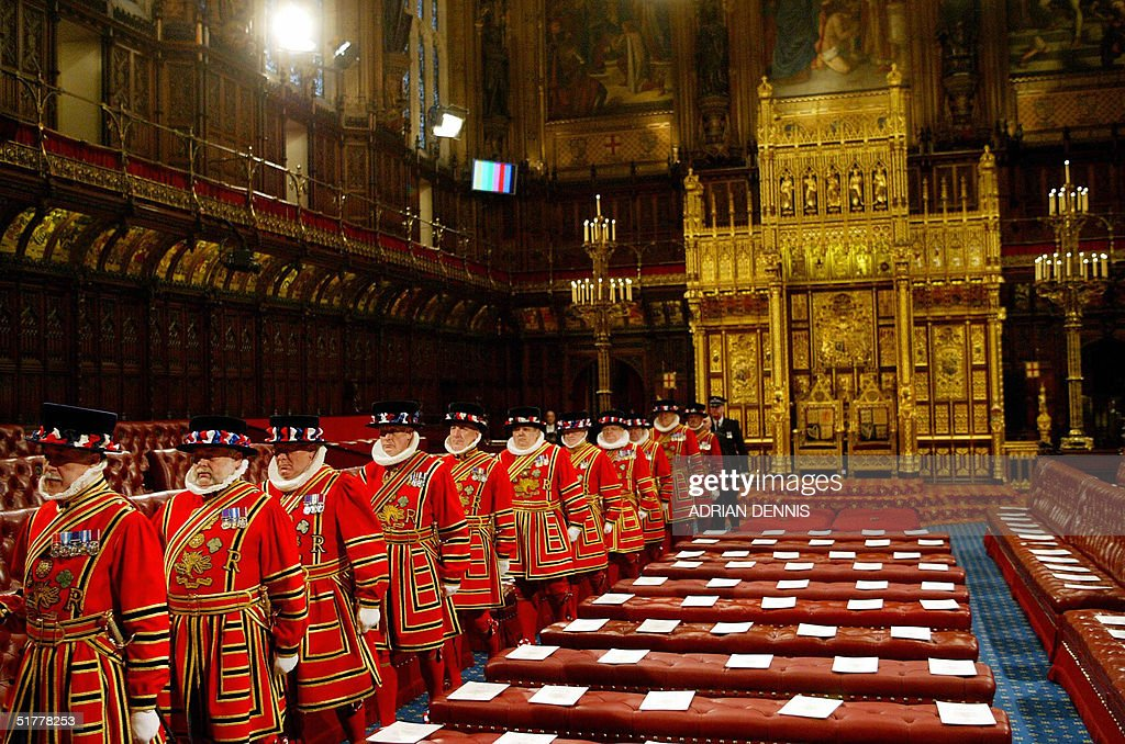 The Queen's Bodyguard walk through The House of Lords as part of the ceremonial search prior to The Queen's Speech during The State Opening of Parliament at The Palace of Westminster in London, 23 November 2004. AFP PHOTO Adrian DENNIS / WPA