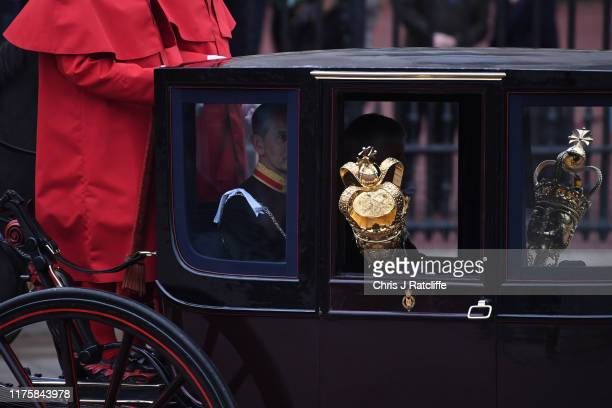 The Queen's ceremonial mace are transported in a carriage along The Mall ahead of the State Opening of Parliament at the Palace of Westminster on...