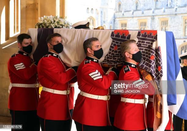The Queen's Company, 1st Battalion Grenadier Guards carry the coffin of Britain's Prince Philip, Duke of Edinburgh in the quadrangle ahead of the...