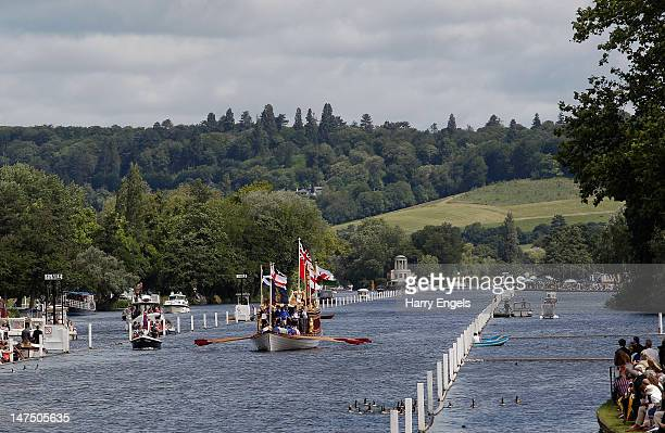 The Queen's Diamond Jubilee barge The Gloriana rowed by twenty former Olympic rowers makes its way down the straight during the final day of the 2012...