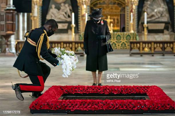 The Queen's Equerry, Lieutenant Colonel Nana Kofi Twumasi-Ankrah, places a bouquet of flowers at the grave of the Unknown Warrior on behalf of Queen...