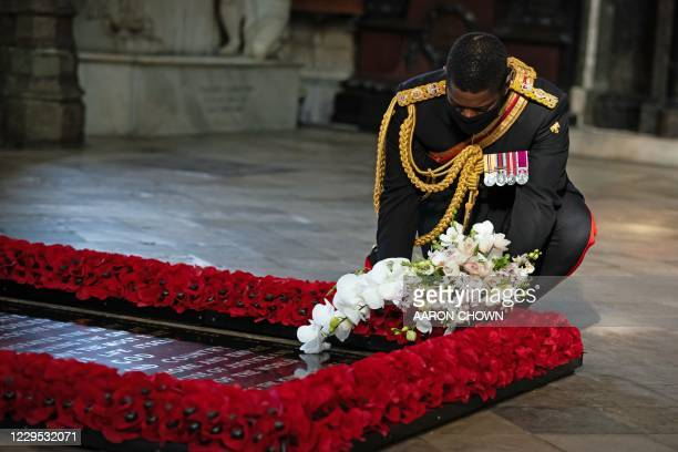 The Queen's Equerry, Lieutenant Colonel Nana Kofi Twumasi-Ankrah places a bouquet of flowers at the grave of the Unknown Warrior to mark the...