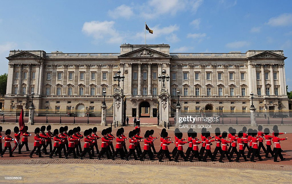 The Queen's Guard march in front of Buckingham Palace in central London on May 25, 2010. Britain's Queen Elizabeth II set out the new coalition government's legislative programme on Tuesday in a ceremony of pomp and history following the closest general election for decades.