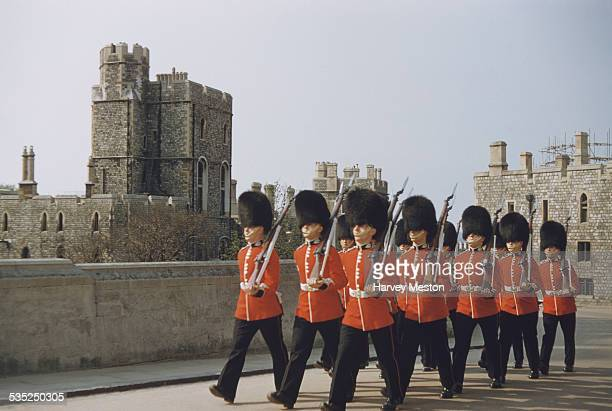 The Queen's Guards marching at Windsor Castle, Berkshire, England, circa 1960.