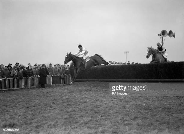 The Queen's horse Manicou with Bryan Marshall up leading Silver Fame right with Dick Francis up at the last fence to win the King George VI Steeple...