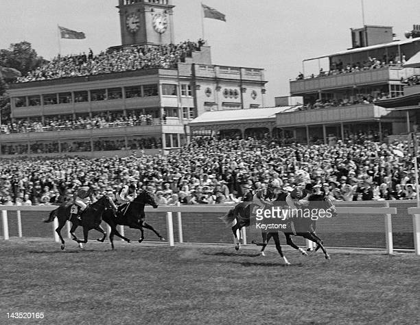 The Queen's horse Pall Mall, ridden by W. H. Carr, wins the New Stakes on the 3rd day of Royal Ascot, 20th June 1957. Troubadour comes in second, and...