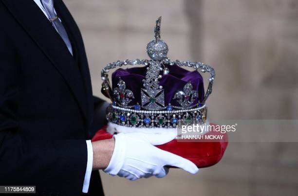The Queen's Imperial State Crown is carried into the Palace of Westminster for the State Opening of Parliament in the Houses of Parliament in London...