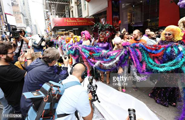 The Queens of The Queen of The Ride hold the worlds longest feather boa during the Guinness World Record with Madame Tussauds New York and Ripley's...